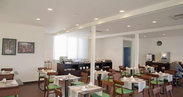 new arrangement of the breakfast room in the roof garden with views of castel sant ' elmo