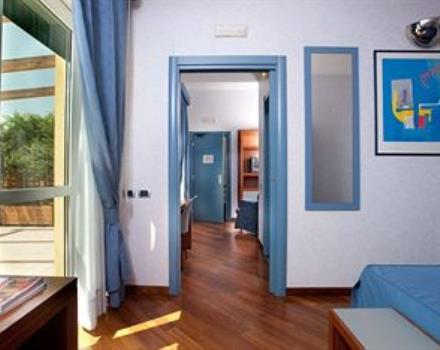 The DeLuxe Room is soundproof and equipped with direct dial telephone, air conditioning, satellite TV, minibar, safe, internet wi-fi, a private bathroom with bathtub and hairdryer.